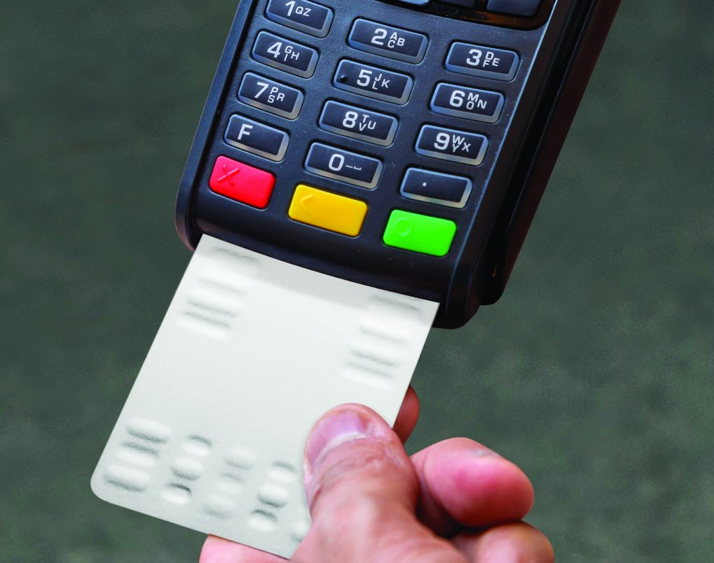 Credit card payment terminal being cleaned with a Waffletechnology Smart Payment cleaning card